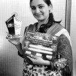 UMT Girl Picture with shield and certificate