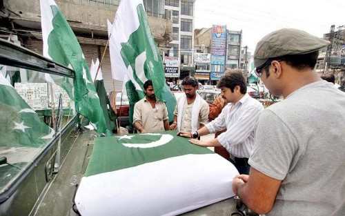pakistan 14 august 2012 flag in car