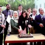 Cake cutting ceremony by Express in Iqra University