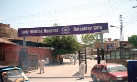 lady-reading-hospital